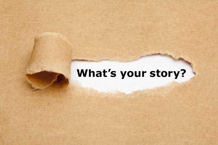 The text What's Your Story appearing behind torn brown paper. Bild: Ivelin Radkov/stock.adobe.com